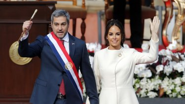 """Paraguayan President Mario Abdo Benitez with his wife Silvana Lopez at his inauguration in Asuncion in 2018. His government is under pressure to explain the deaths of two girl """"rebels"""" at the hands of security forces."""