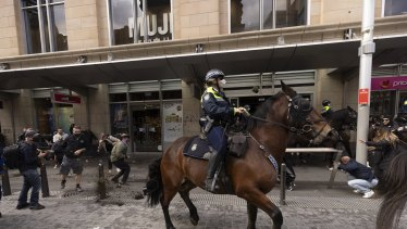Mounted police were pelted with pot plants during last month's protest.