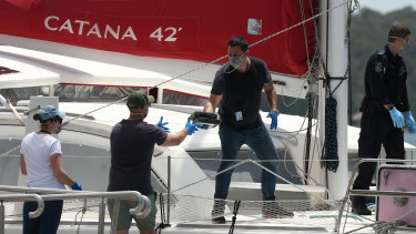 Police remove cocaine off the yacht on November 16, 2017.