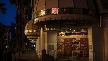 Lights illuminate an empty sidewalk in Las Vegas, Nevada.