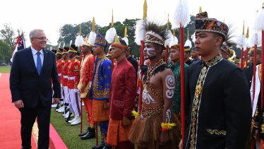 Scott Morrison inspects a guard of honour at Bogor Presidential Palace near Jakarta on Friday.