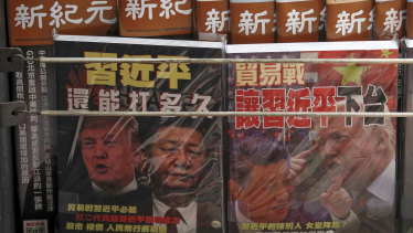 Chinese magazines with front covers featuring Chinese President Xi Jinping and US President Donald Trump on trade war are placed for sale at a roadside bookstand in Hong Kong. China.