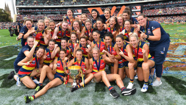 The Crows celebrate with the premiership cup.