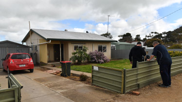 Police at the property in the country town of Maitland, South Australia, on Thursday.