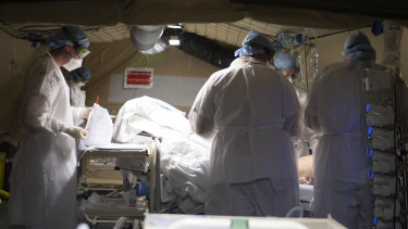 Military doctors work in the military field hospital in Mulhouse, eastern France.