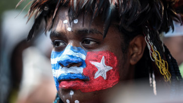 "A Papuan student protests in Jakarta  last August with face painted in the colours of the banned separatist ""Morning Star"" flag."