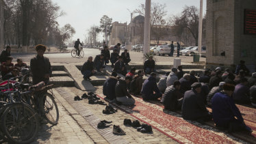 Muslims pray during Friday service in Bukhara, Uzbekistan.
