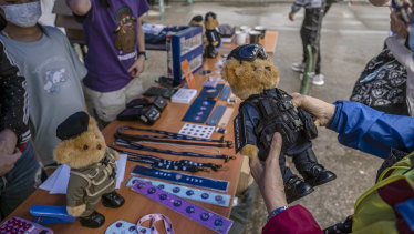 Riot-gear-clad teddy bears, for sale at the Hong Kong Police College in Hong Kong during National Security Education Day.