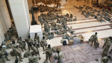 Hundreds of National Guard troops stationed inside the US Capitol ahead of the impeachment vote.