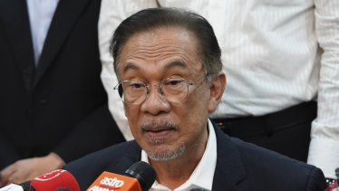 Anwar Ibrahim speaks during a press conference at the headquarters of the Alliance of Hope after meeting the king in Kuala Lumpur, Malaysia, on Wednesday.