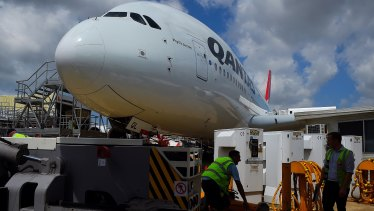 SafeWork NSW has ordered the airline to consult with a health specialist to develop a system specifically to deal with COVID-19.