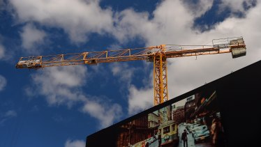A crane works on a building site in Chippendale, Sydney