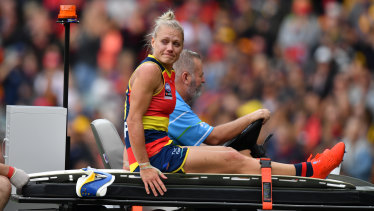 Erin Phillips starred for Adelaide in the AFLW grand final before being carried from the ground after suffering a knee injury.
