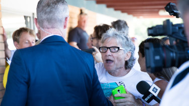 The man had a physical altercation with plain-clothed security officers after trying to reach Gladys Berejiklian to ask a question.