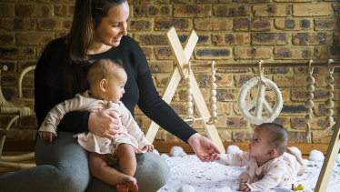 Camille Aniversario, with her 7 month old twins Franki and Gigi,