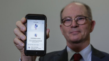 Deputy Chief Medical Officer Professor Paul Kelly with the COVIDSafe app.