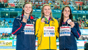Ariarne Titmus, centre, after winning gold in the 400m freestyle at the World Championships in South Korea.