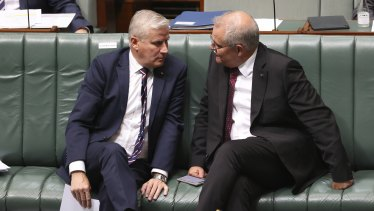 Deputy Prime Minister Michael McCormack and Prime Minister Scott Morrison during Question Time at Parliament House in Canberra on Tuesday 23 March 2021