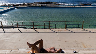 A sunseeker finds what he was looking for at Dee Why on Wednesday.
