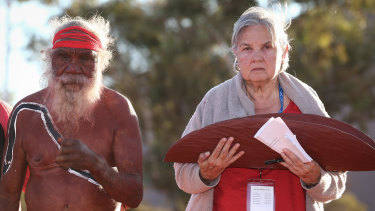 Mutitjulu elder Rolley Mintuma and Pat Anderson from the Referendum Council with a piti holding the Uluru Statement from the Heart last year.