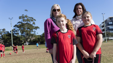 Finding car parks near sporting fields on Saturdays is a nightmare for Melinda O'Brien, back left, and Jodi Backhouse. They are pictured with their daughters Alana and Oliva, both 9, at North Caringbah Oval.