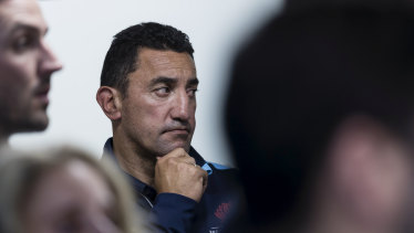 Time to go: Daryl Gibson watches on as Waratahs boss Andrew Hore addresses the media in the wake of the coach's departure.