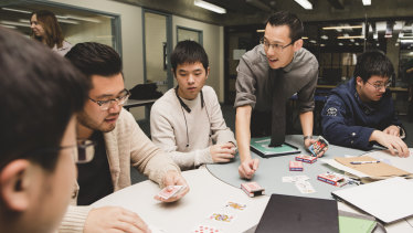 Eddie Woo in his element, running a special workshop for specialist maths students at Hawker College in Canberra