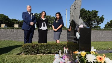Graham Boyd (left) the CEO of the Southern Metropolitan Cemeteries Trust,  Professor Marie-Paule Austin from the Royal Hospital for Women and Filomena D'Alessandro at the grave of baby Lily Grace.