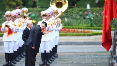 North Korean leader Kim Jong-un bows as he stands alongside Nguyen Phu Trong, Vietnam's President, during a welcoming ceremony at the Presidential Palace in Hanoi, Vietnam, on March 1, 2019.