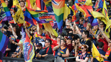 Loud and proud: Adelaide supporters fly the flag during the AFLW grand final between the Crows and the Blues at Adelaide Oval.
