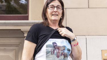 Outside court on Wednesday, Caterina Politi, the mother of one-punch victim David Cassai, displays a T-shirt in his honour.