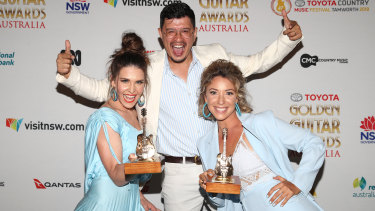 Fanny Lumsden (left), with Dan Stanley and Anna Phillips after winning Music Video of the Year at the Golden Guitar Awards at the 2018 Country Music Festival in Tamworth.