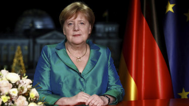 German Chancellor Angela Merkel poses for media after the recording of her annual New Year's speech at the Chancellery in Berlin.
