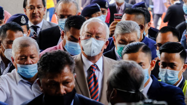 Najib Razak, Malaysia's former prime minister, centre, arrives at the Kuala Lumpur Courts Complex in Kuala Lumpur, Malaysia, on Tuesday.