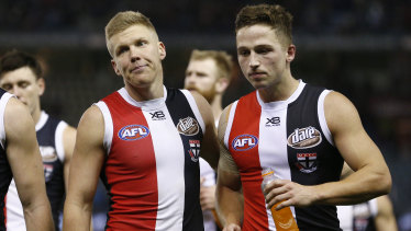 Dan Hannebery (left) and Jack Billings head off the ground after the big loss to the Lions.
