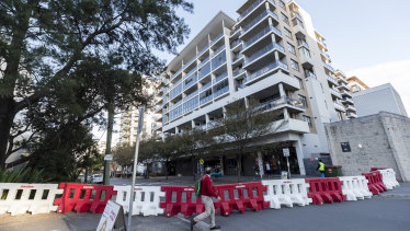 Residents were told to evacuate the building after cracks were discovered in the downstairs car park.