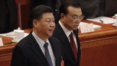 Chinese President Xi Jinping, left, and Chinese Premier Li Keqiang arrive at the opening session of China's National People's Congress last week.