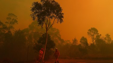 As the fire front approaches an RFS crew assesses the perimeter at Barden Ridge, Sydney.