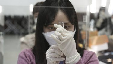 A medical worker attends a training session to learn how to give coronavirus vaccine shots at the Korean Nurses Association in Seoul.