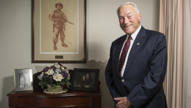 Major General Peter Phillips (Ret) was the commander of D Company, 3 RAR, during the battle of Coral Balmoral. He is pictured with an iconic image of a digger in New Guinea by Ivor Hele.