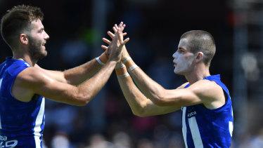 Luke McDonald and Bailey Scott (right) celebrate during a pre-season match. Scott has had an immediate impact.