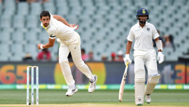 Wild: Mitchell Starc unleashes, with some misdirection, on day four at Adelaide.