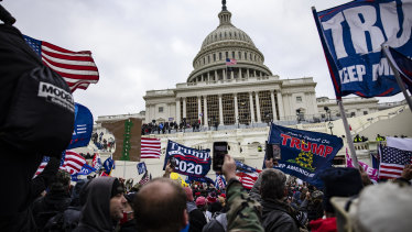 Pro-Trump supporters storm the US Capitol following a rally with President Donald Trump.