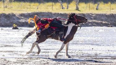 A Mongolian horseman at the Wulan Butong Grasslands.