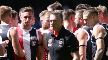 At ease: Alan Richardson with his players during their narrow round one win over Gold Coast.