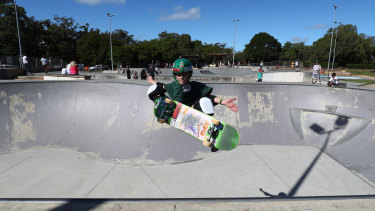 Skateboarders use the ramps at Pizzey Park on the Gold Coast.