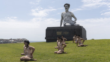 Impersonators pose with a six-metre statue of Borat at Bondi's Marks Park.