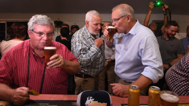 Shane Stone, left, has a beer with Prime Minister Scott Morrison in Cloncurry the week after the May 2019 election.