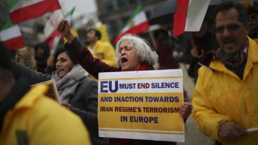 Activists of the National Council of Resistance of Iran shout slogans outside the European Council headquarters during a EU Foreign Ministers meeting on Friday.