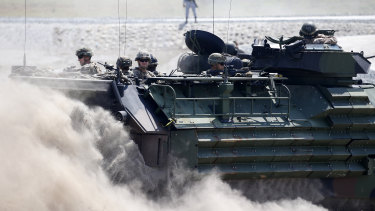 Amphibious Assault Vehicles, AAVs, carry American and Philippine troops in joint exercises in April.